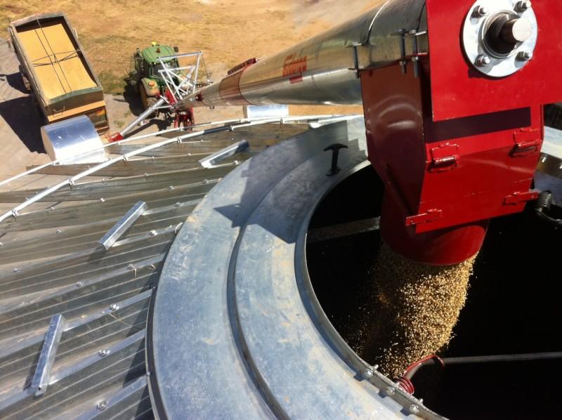 10 inch by 72 foot galvanized auger loading a grain bin